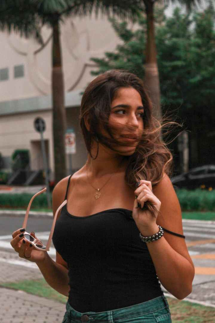 photo of woman wearing black camisole