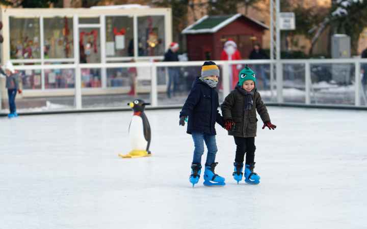 two children inside of ice skating field