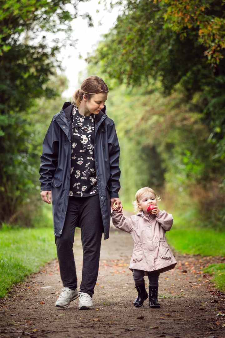 woman walking with child on pathway