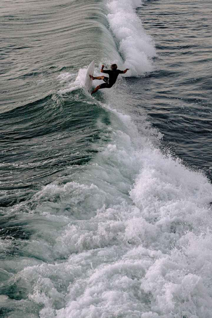 photo of person surfing on the sea