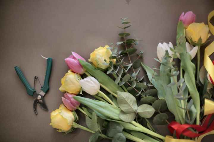 colorful flowers bouquet near pruning scissors